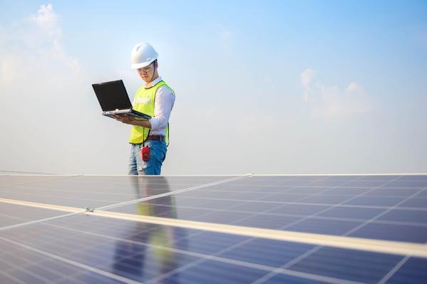 solar engineer running a check